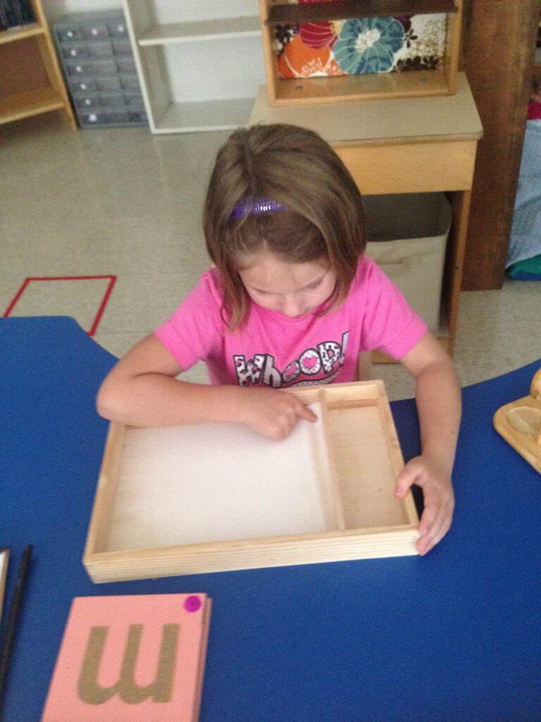 Tracing The Sandpaper Letter And Drawing It In Sand Tray Regarding Letter Tracing In Sand
